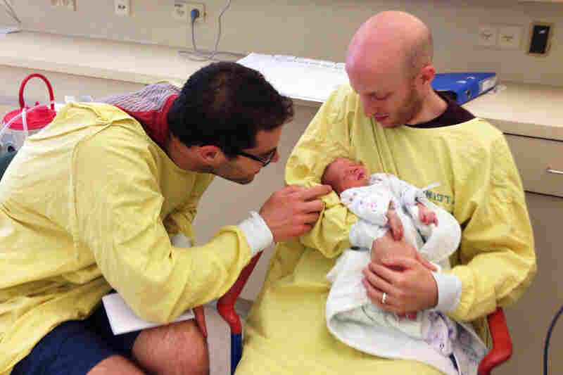 Now this is an international baby: Born to a surrogate mom in Nepal (who was implanted with an egg from a South African donor) and now living in Israel with his parents, Amir Vogel Greengold (left) and Gilad Greengold.