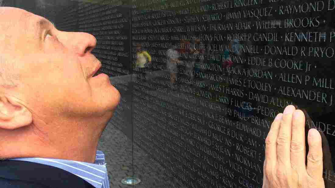 Jan Scruggs gazes up at the names of fellow military service members inscribed on the Vietnam Veterans Memorial in Washington, D.C.