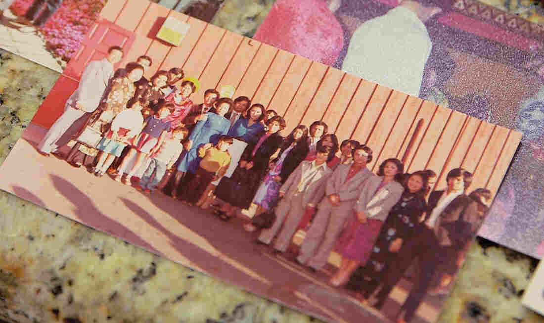 A photo of the Nguyens' extended family. Most of the individuals pictured lived in a two-bedroom apartment together after leaving Camp Pendleton.