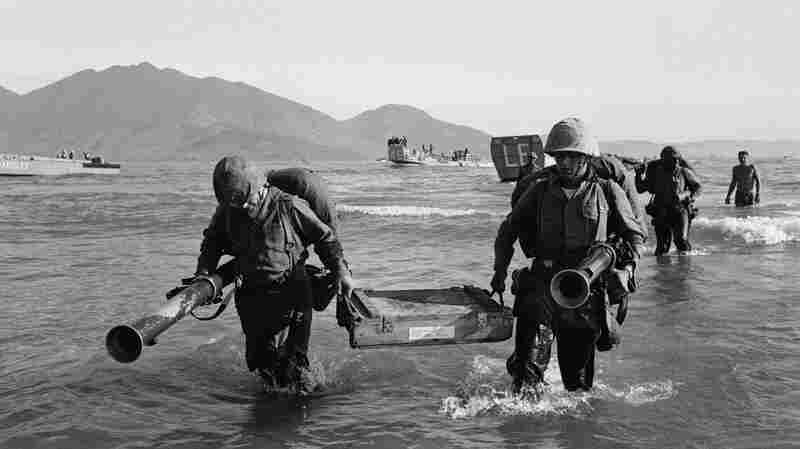 Members of the 9th U.S. Marine Expeditionary Force go ashore at Danang, South Vietnam, on March 8, 1965. Assigned to beef up defense of an air base, they were the first U.S. combat troops deployed in the Vietnam War.