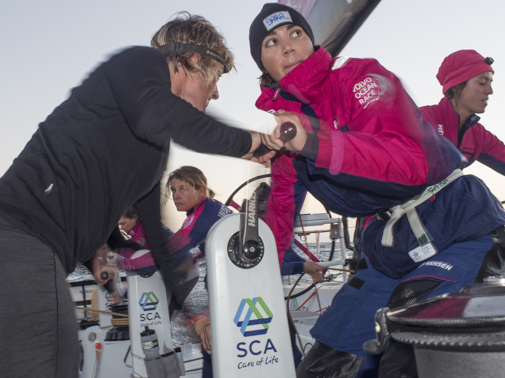 Leg 1 onboard Team SCA. Sara Hastreiter and Abby Ehler tack during the early hours of the day, in October 2014.