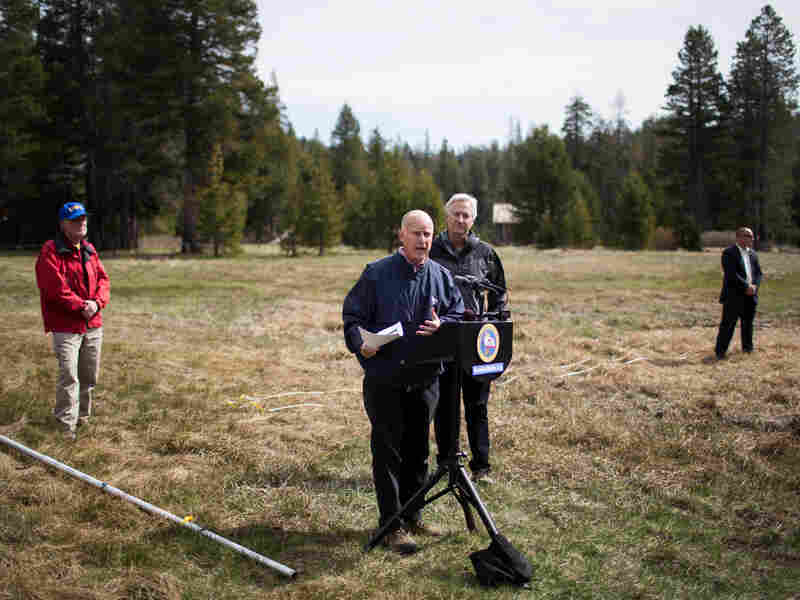 Gov. Jerry Brown announced mandatory statewide water restrictions at the site of a manual snow survey on April 1, in Phillips, Calif. The recorded level was zero, the lowest in recorded history for California.