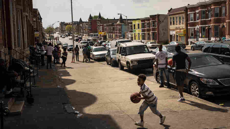 "A boy plays in the Sandtown neighborhood, where Freddie Gray was arrested, on April 30. ""Every day, this is the atmosphere,"" Addison says. ""It's not an atmosphere of aggression. It's not an atmosphere of violence!"""