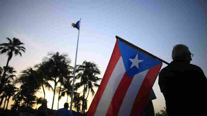 Protesters gather April 30 Outside of Puerto Rico's Capitol building in San Juan to oppose Gov. Alejandro Garcia Padilla's budget proposal. The plan would raise taxes to help cover the state's massive debt.
