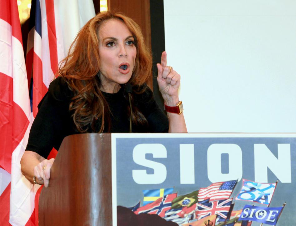 "Blogger Pamela Geller speaks at a Sept. 11, 2012, conference she organized in New York titled ""Stop Islamization of America."" (David Karp/AP)"