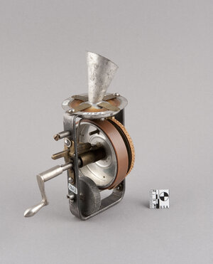 The dolls held a miniature phonograph that was spring-activated by a crank sticking out of the doll's back.
