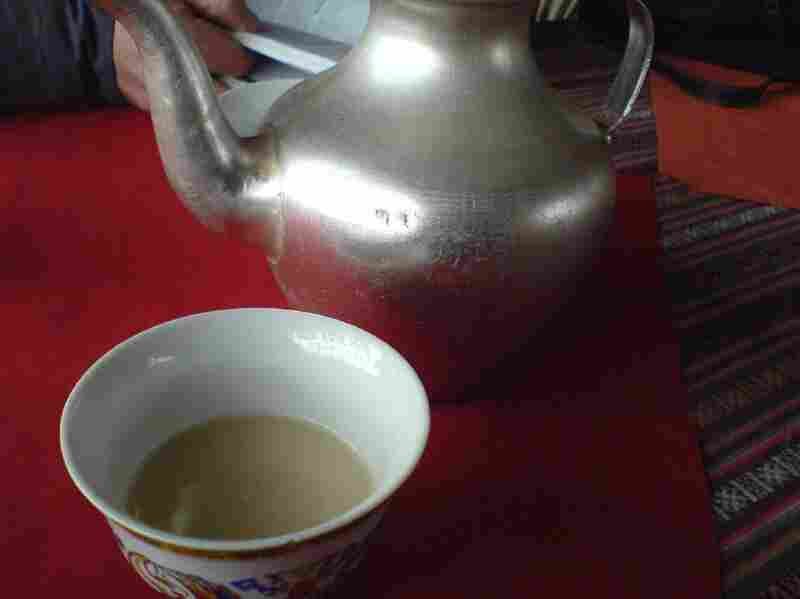 Yak butter tea is yellowish in color and has the consistency of soup.