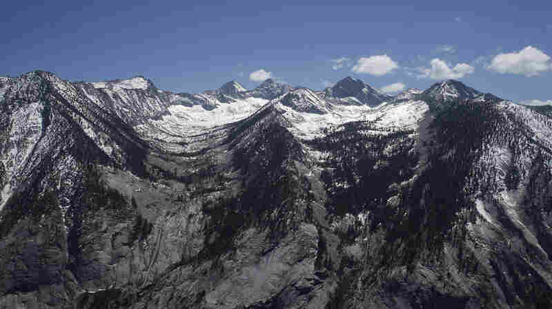Mountain tops in Sierra Nevada, normally covered in snow this time of year, are seen nearly barren, near the Sequoia National Park during an aerial survey of the snowpack done by the California Department of Water Resources.