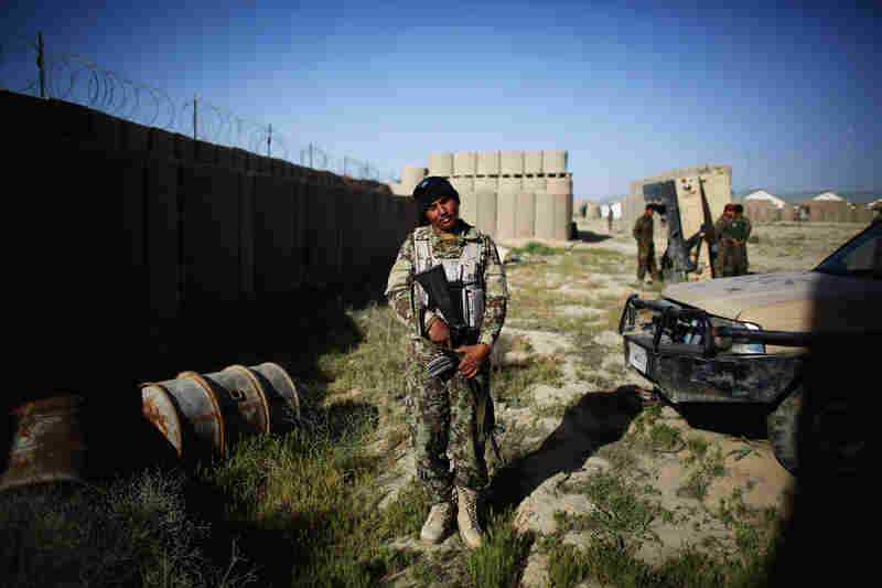 An Afghan soldier at Camp Eagle prepares to leave for a morning patrol.