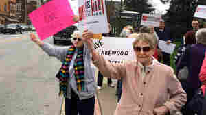 """Ann Allen (right) and Marie Birsic (left) take part in a demonstration to prevent the closure of Lakewood Hospital on Cleveland's West Side. Birsic says the neighborhood will """"go down into a ghost town"""" once the hospital is turned into an outpatient center."""