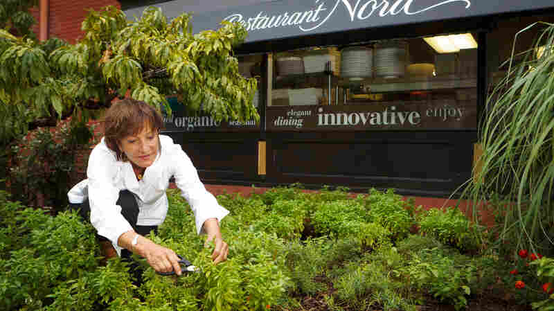 Chef, cookbook author and owner of Washington, D.C.'s Restaurant Nora, Nora Pouillon, in the restaurant's garden.