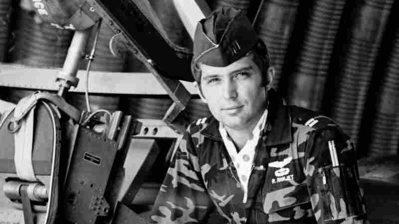 """Capt. Roger Moseley sits on the wing of an A-37 attack aircraft at Bien Hoa Air Base in Vietnam in 1971. His call sign in Vietnam was Ramjet — """"because I don't have a lot of patience,"""" Moseley says."""