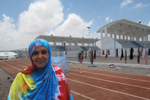 Raja Abdulkhadr is a lawyer from Yemen. She is now staying at an old soccer stadium, hoping that another country might accept her family.