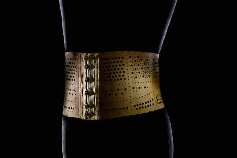 "This ""Elancia"" man's stomach belt was popular around the turn of the 20th century. It's made of perforated rubber, silk and metal hooks and eyes."