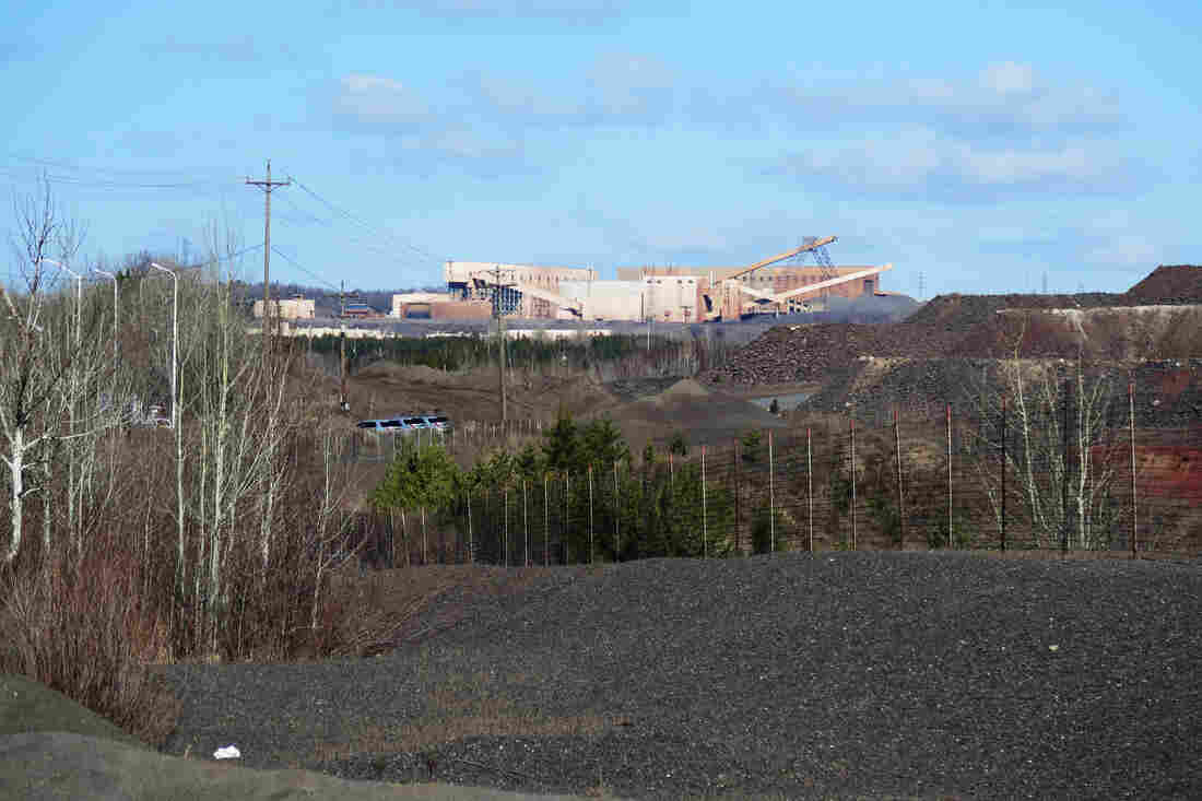 U.S. Steel's Minntac taconite mine and plant looms over the city of Virginia. The company plans to lay off around 700 employees on June 1.