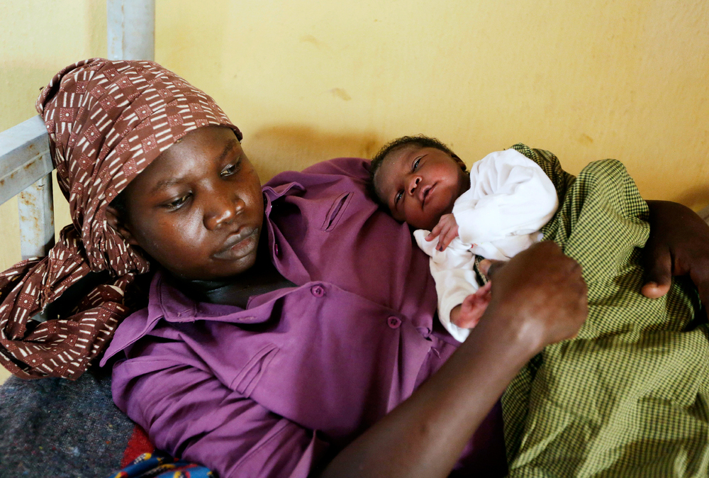 Lami Musa, 27, cradles her 5-day-old baby girl at a refugee camp clinic. One of the women rescued from Boko Haram, she says her husband was killed before she was abducted by Islamist extremists.