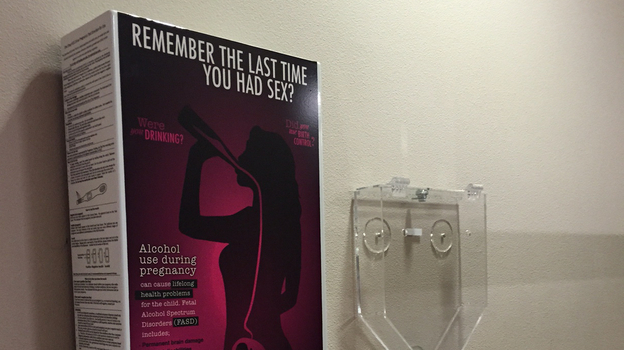 A Free Pregnancy Test Dispenser Hangs Next To A Condom Dispenser In The Women 39 S Restroom At The