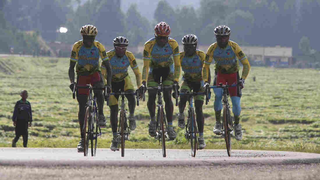 Team Rwanda rides together in a scene from the 2013 documentary Rising From Ashes.