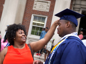 Ariel Alford and Leighton Watson exchange congratulations after Howard University's graduation commencement on Saturday.