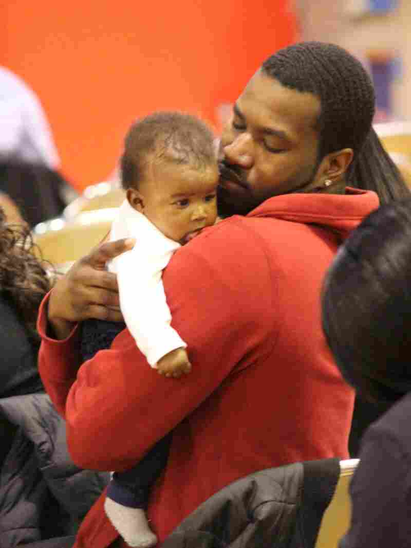 Tyrone Johnson holds his daughter, Rylee Broxton, during a recent Baby College graduation. The program teaches parents about childhood development, discipline and language skills.