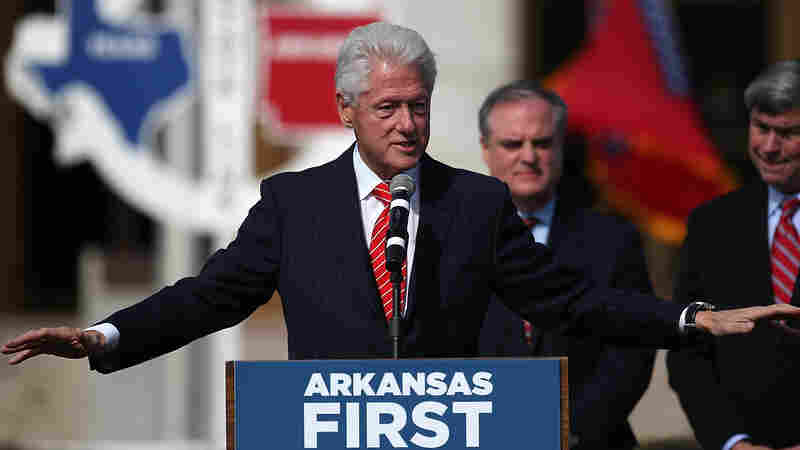 Former President Bill Clinton campaigns before the 2014 elections for former Sen. Mark Pryor, center, and Mike Ross, right, the Democratic candidate for governor.