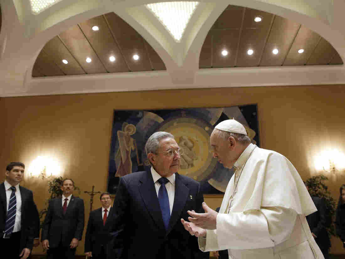 Pope Francis talks with Cuban President Raul Castro during a private audience at the Vatican on Sunday.