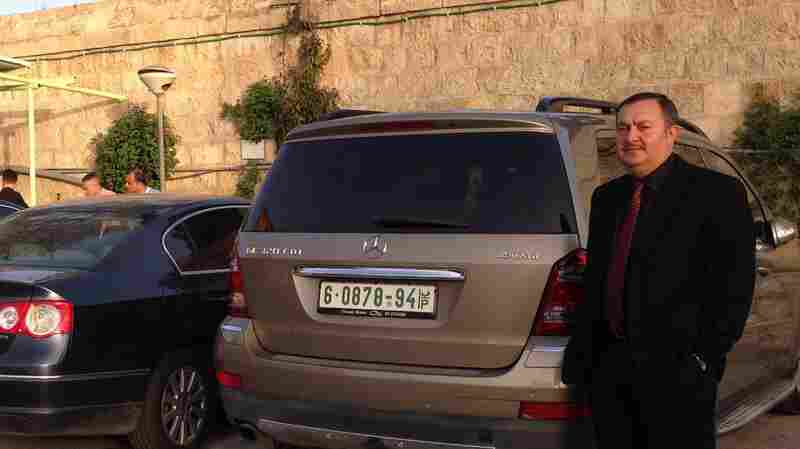 For many commuters, standing in the parking lot after driving to work wouldn't be noteworthy. But for rheumatologist Anas Muhana, it's a big deal. He's one of only 100 Palestinian West Bank residents now permitted to drive his own car, with its white-and-green plates, to his job in Israel. The Israeli military banned Palestinian-plated cars for the past 15 years.