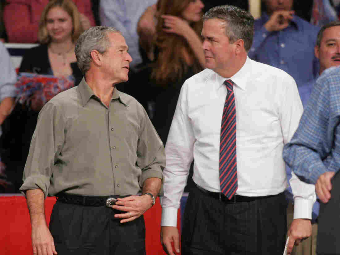Then-President George W. Bush jokes with his brother Jeb, the then-Florida governor, in 2006. Jeb Bush has been asked before, and is sure to be again, how he would distinguish himself from his brother.