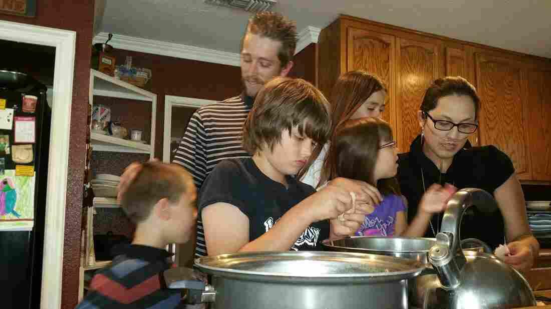 Stephanie and Brian Packer make lunch with their children, Brian, 11, Savannah, 5, Scarlett, 10, and Jacob, 8.