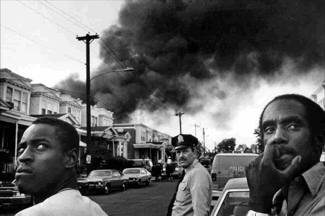 The scene at the corner of 62nd and Larchwood on the afternoon of May 13, 1985, following the dropping of a bomb on MOVE headquarters.