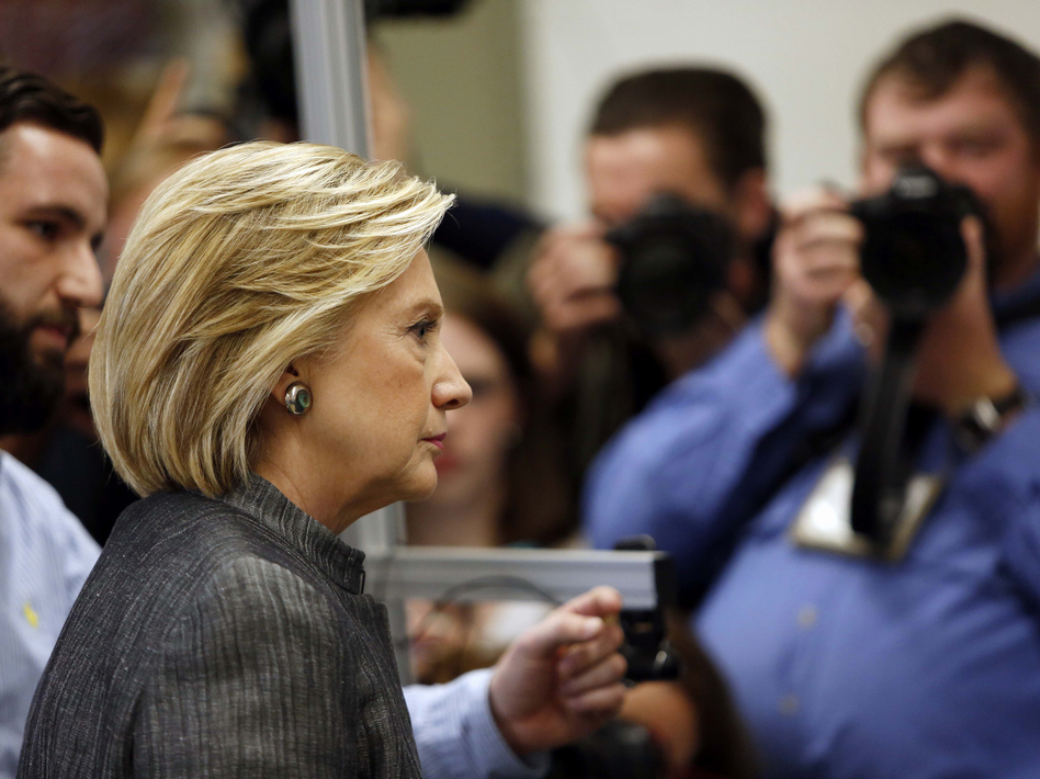 Democratic presidential candidate Hillary Clinton tours a lab during a campaign stop at New Hampshire Technical Institute in April. (Jim Cole/AP)