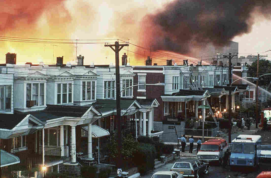 Flames shoot skyward at the MOVE compound in West Philadelphia on May 13, 1985.