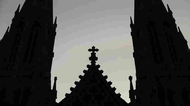 A cross stands above St. Patrick's Cathedral in New York City.