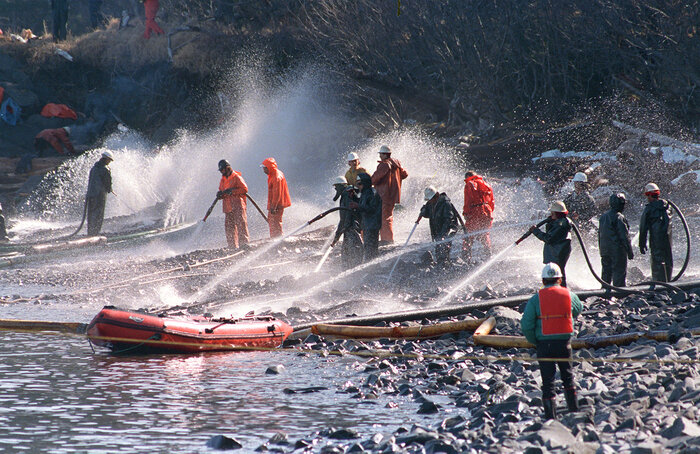 Workers try to remove some of the 11 million gallows of oil spilled by the Exxon Valdez off Alaska in 1989.