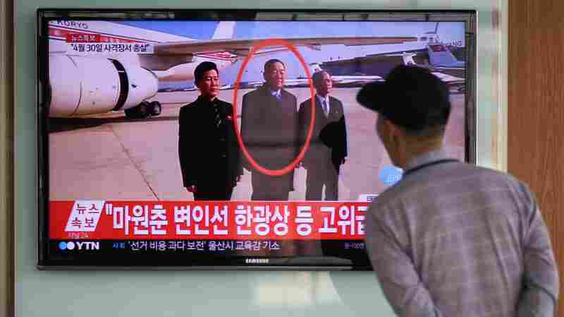 A man watches a television showing news coverage of the reported execution of North Korea's defense minister, Hyon Yong Chol, at a railway station in Seoul on Wednesday.