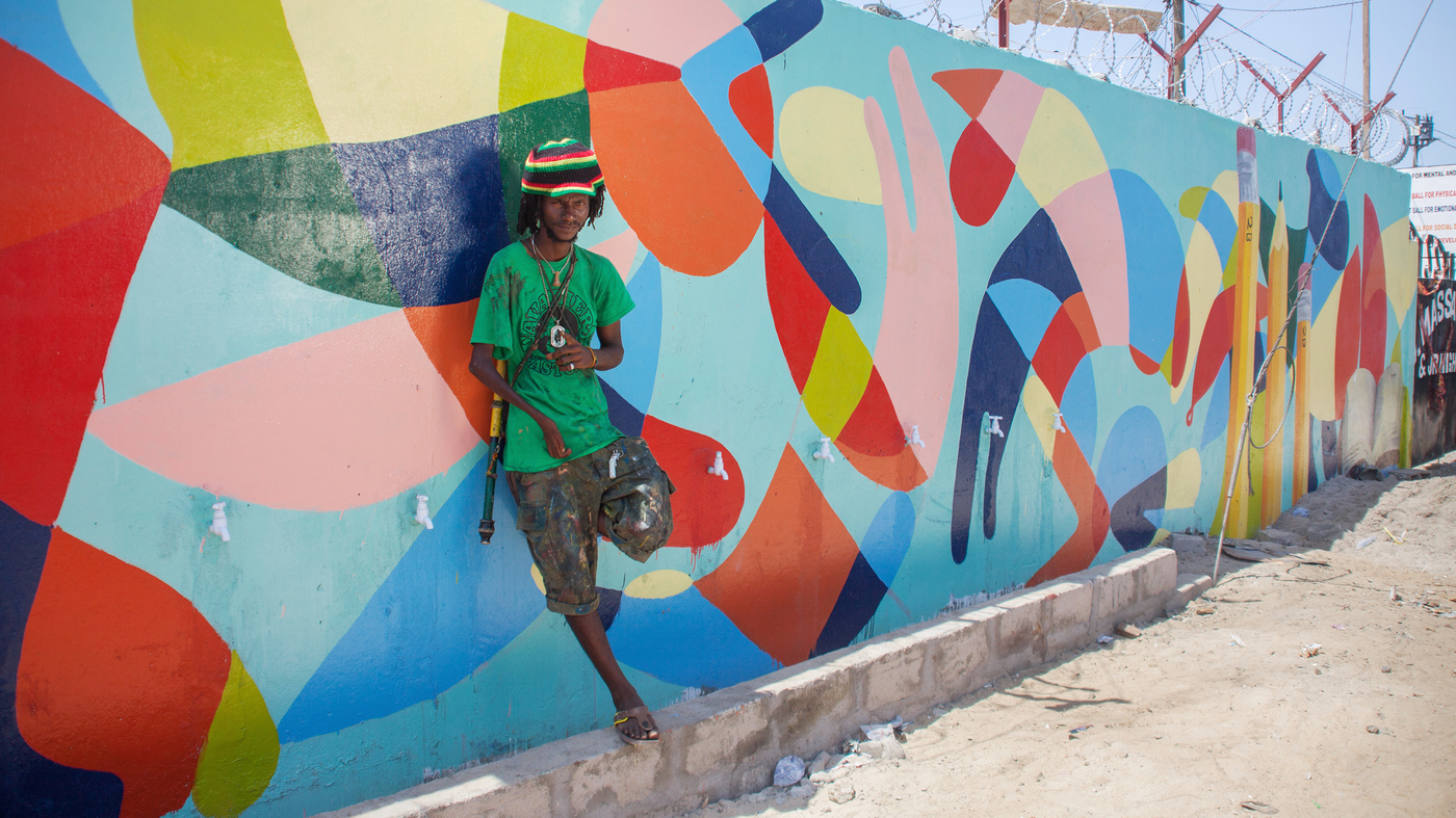 Baltimore artist helps turn liberian school into a mural for Baltimore mural program