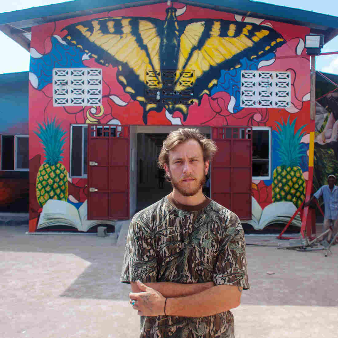 "David ""Nanook"" Cogdill, an American street artist, came to Liberia to create a welcoming mural for a school that had been damaged by riots during the Ebola outbreak."