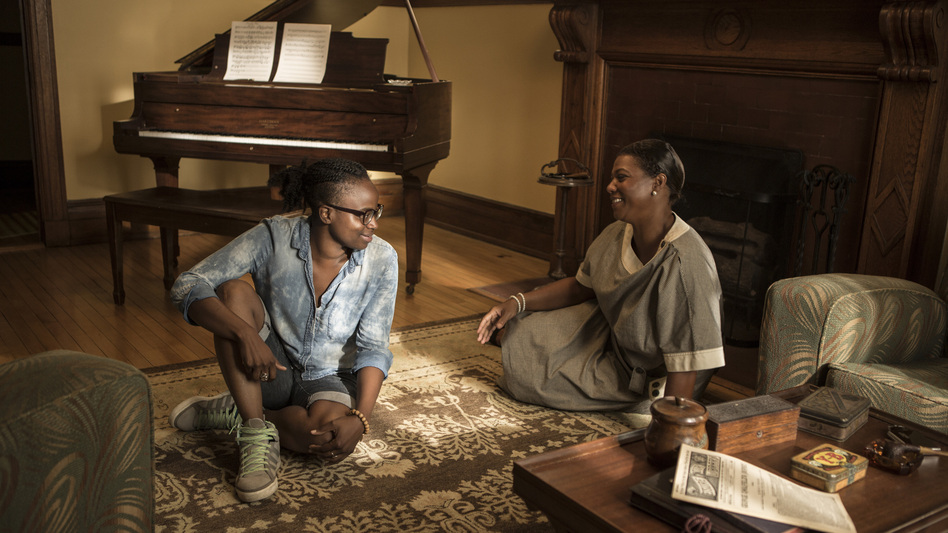 Director Dee Rees (left) with Queen Latifah on the set of Bessie. (Courtesy of HBO)