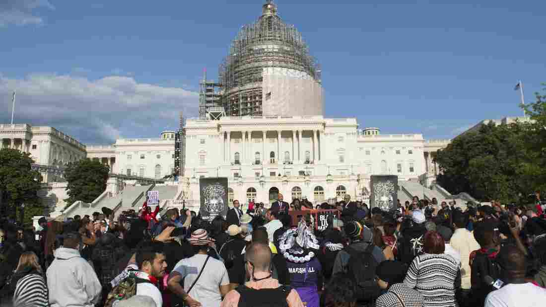 Demonstrators participated in a March2Justice for criminal justice reform legislation outside the Capitol in April. Lawmakers who are working to on fixes to the justice system say recent unrest is pushing them to act.
