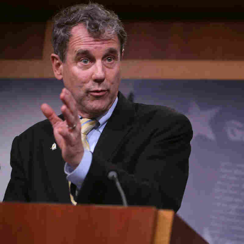 """Sen. Sherrod Brown, seen here speaking about the trade bill Tuesday, told NPR """"I bet that none of my colleagues have read the entire document. I would bet that most of them haven't even spent a couple hours looking at it."""" Brown acknowledged he has yet to read every single page of the trade agreement."""