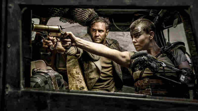 Charlize Theron as Furiosa, alongside Tom Hardy's Max Rockatansky in the new Mad Max: Fury Road.