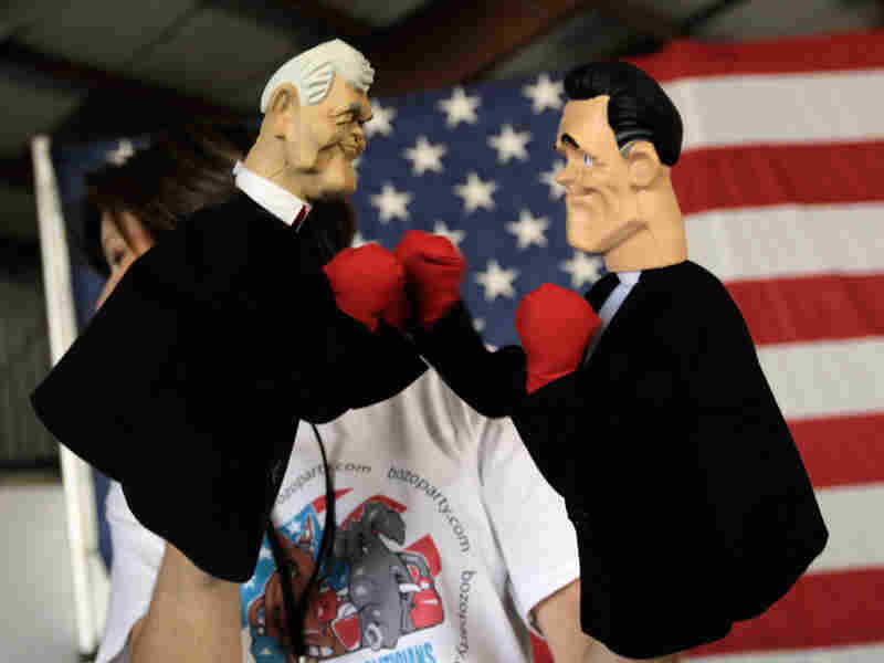 Boxing puppets of Newt Gingrich and Mitt Romney in January 2012.