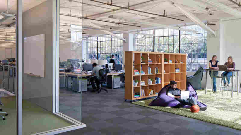 """A """"shared"""" workspace at the Atlassian office. The company installed heat and motion sensors to track when and how often every desk, room and table was used."""