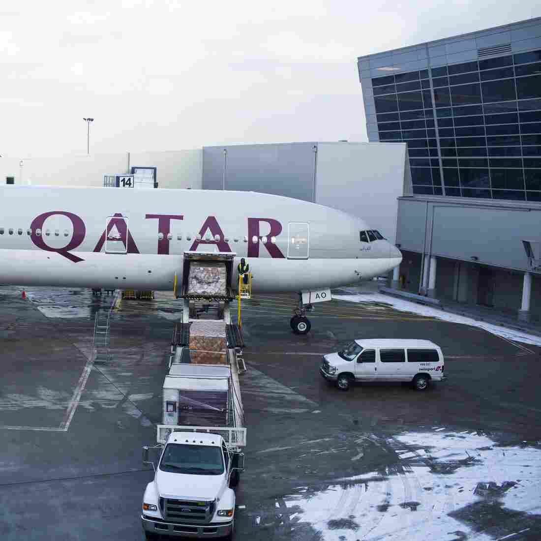"""A Qatar Airways plane loads cargo on Feb. 3, 2013, at  John F. Kennedy International Airport in New York. The big three U.S. airlines — Delta, United and American — say Persian Gulf carriers like Qatar Airways, Emirates Airlines and Etihad are """"dumping"""" seats in the U.S."""
