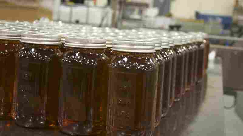 "Jars of Terressentia bourbon wait for final production. Terressentia uses a process to artificially ""age"" its bourbon in a few hours, forgoing traditional aging, which takes years."