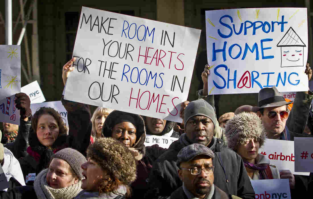 Supporters of Airbnb hold a rally outside City Hall, in New York. Cities throughout the country have been cracking down on the vacation rental site, prompting protests like these across the country.