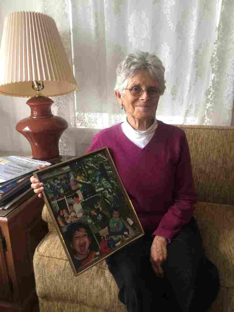 Santa Monica homeowner Arlene Rosenblatt shows off a photo of her grandchildren. When she goes to visit them, she rents out her home through websites like Airbnb. New rules in Santa Monica make Rosenblatt's rentals illegal.