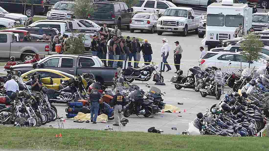 Authorities investigate a shooting in the parking lot of the Twin Peaks restaurant Sunday in Waco, Texas. Authorities say the shootout victims were members of rival biker gangs that had gathered for a meeting.