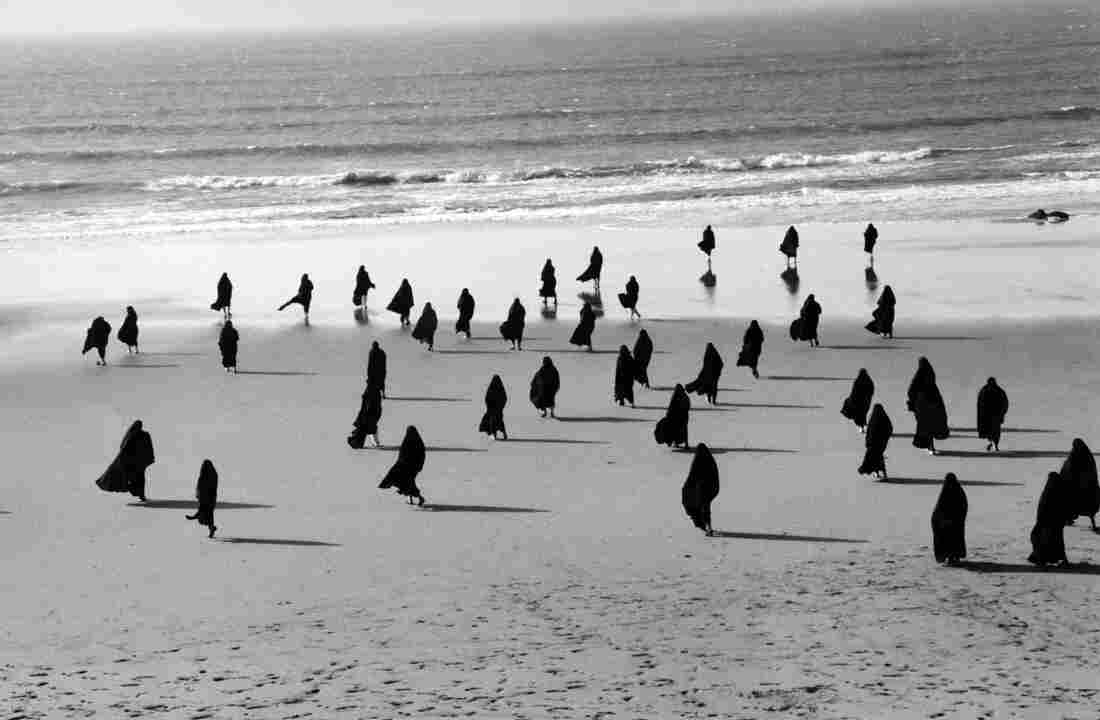 Shirin Neshat is an Iranian-born visual artist who has made her home country's turbulent history the subject of high art. The Hirshhorn Museum in Washington, D.C., is hosting a retrospective of her work. Above, Neshat's 1999 Rapture Series.
