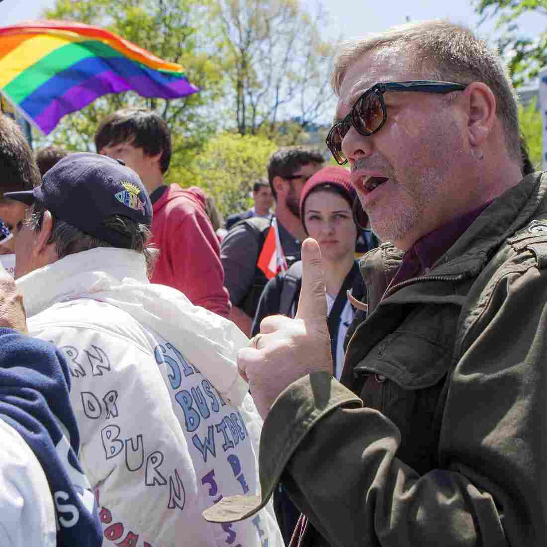The Supreme Court will rule on same-sex marriage next month; here, Reverend Scott Hopkins, right, of United Methodist Church in Vienna, Va., voices his support of gay marriage as Tracy Grisham, of Amarillo, Texas, voices her disapproval.